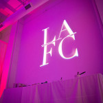 So exciting to have our logo flashing on the wall! - LA Fashionista Compassionista