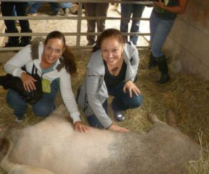 My friend Beth and me, rubbing pig bellies at CAS!