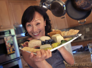 Vegan cookbook author Miyoko Schinner holds a plate of her homemade cheese on Monday, Oct. 1, 2012, in San Anselmo, Calif. She has written a new cookbook about artisan vegan cheeses. (IJ photo/Frankie Frost)