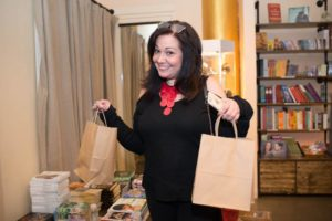 Our Editor Adrienne Borgersen helps distribute gift bags.